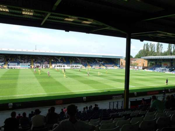 Gigg Lane, vak: South Stand, rij: T, stoel: 54