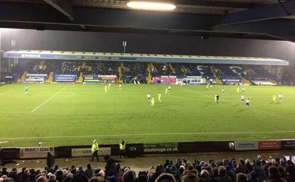 Gigg Lane, vak: East Stand, rij: Back